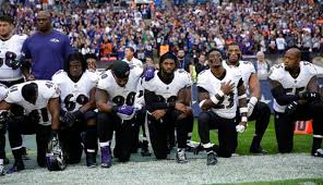NFL Players kneeling