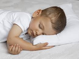 child with pillow